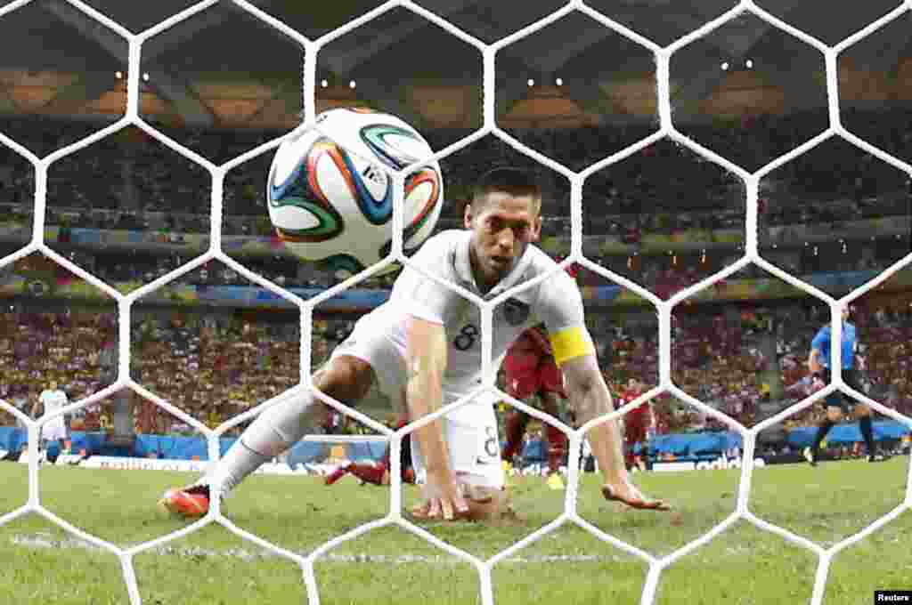 Clint Dempsey of the U.S. watches after knocking the ball into the net against Portugal at the Amazonia arena in Manaus, June 22, 2014.