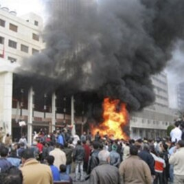 The local government headquarters is set on fire by protesters, claiming delays on requests for housing in Port Said, Egypt, February 10, 2011