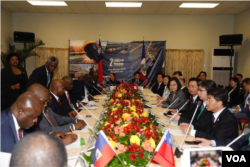 台湾政府和海地政府7月13日举行双边会谈。