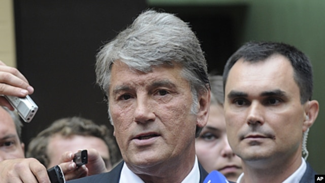 Former Ukrainian President Viktor Yushchenko speaks to the media after he testified against his 2004 Orange Revolution partner, ex-premier Yulia Tymoshenko, in her abuse of office trial in central Kyiv, Ukraine, August 17, 2011