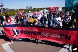People take part in a Power Together Women's March, Oct. 17, 2020, in Nashville, Tenn. Dozens of women's rallies were planned across the U.S. to signal opposition to President Donald Trump and his policies.