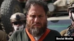 امنیت ملی افغانستان این فرد را اسلم فاروقی معرفی کرده است