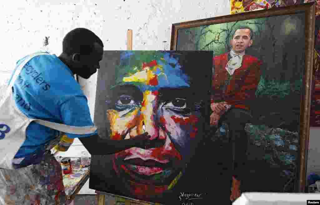 "Kenyan artist Evans Yegon alias ""Yegonizer"" works on a portrait of U.S. President Barack Obama at a studio inside the Go-Down Art Center in Nairobi. Kenya is preparing for a visit by Obama in the coming week."