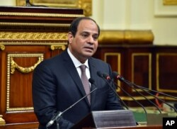 FILE - In this photo provided by Egypt's state news agency MENA, Egyptian President Abdel-Fattah el-Sissi, addresses parliament in Cairo, Feb. 13, 2016.