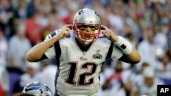 FILE - New England Patriots quarterback Tom Brady calls a play against the Seattle Seahawks during the first half of Super Bowl XLIX in Glendale, Arizona, Feb. 1, 2015.
