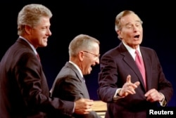 Independent Ross Perot (C) seen here with Democratic Presidential nominee Governor Bill Clinton (L) and President George Bush at the 1992 presidential debate in Michigan, went on to win 19% of the popular vote in the November 1992 election.