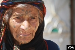 One-hundred-year-old Tamam Shaheen balked at IS orders to veil her face or quit smoking, but in the wake of IS rule, her grandson is now imprisoned and accused of having fought alongside the group, in Sarran, Syria, Aug. 18, 2017. (H. Murdock/VOA)