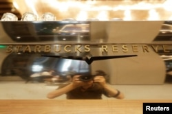 A logo of Starbucks Reserve is pictured at its new flagship store in Beijing's Qianmen area, China, June 30, 2018.