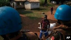 FILE - U.N. peacekeepers patrol the town of Bangassou, Central African Republic, Feb. 15, 2021.