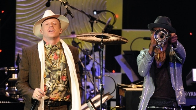 Recording artist Macklemore performs onstage at The 56th Annual GRAMMY Awards Salute to Industry Icons with Clive Davis, on Jan. 25, 2014 at the Beverly Hilton Hotel in Beverly Hills, Calif.