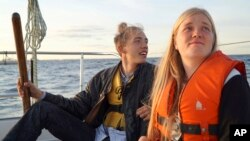 Annika Holm Nielsen (r), and Calle Vangstrup sail in the Oresund strait between Copenhagen and Malmo, Sweden, Sept. 9, 2015.