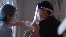 A man receives a shot of the Moderna COVID-19 vaccine in Vung Tau, Vietnam, Sep. 13, 2021.