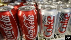 Cans of Coca-Cola and Diet Coke are shown in a cooler in Anne's Deli Thursday, March 17, 2011, in Portland, Ore.