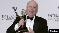 FILE - British producer Julian Fellowes, creator of Downton Abbey, poses with the International Emmy Founders Award backstage at the 43rd International Emmy Awards Gala in Manhattan, New York, Nov. 23, 2015.
