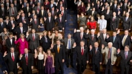 Members of the 113th U.S. Congress take the oath of office in the House of Representatives chamber on Capitol Hill in Washington, Thursday, Jan. 3, 2013.
