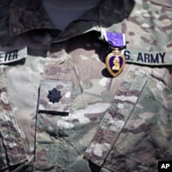FILE - A Purple Heart medal is seen on the uniform of U.S Army Lt Colonel Alan Streeter after U.S. Secretary of Defense Robert Gates presented the award for wounds he received in combat, during a ceremony at Combat Outpost Andar in Ghazni Province, Afghanistan.
