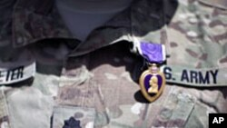 A Purple Heart medal is seen on the uniform of U.S Army Lt Colonel Alan Streeter.