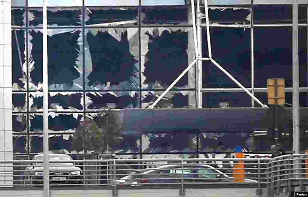 Broken windows seen at the scene of explosions at Zaventem, March 22, 2016.