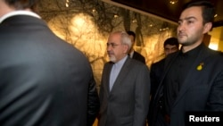 Iranian Foreign Minister Mohammad Javad Zari, center, departs meeting with EU foreign ministers, Iran Nuclear talks, Geneva, Nov. 9, 2013.