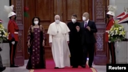 Iraqi President Barham Salih, his wife Sarbagh Salih, and Pope Francis attend a welcoming ceremony at the Presidential Palace during the Pope's historic tour in Baghdad, Iraq, March 5, 2021, in this screen grab taken from video. (Iraqiya TV/Reuters TV)