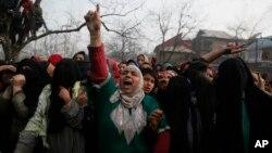 A Kashmiri woman shouts pro freedom slogans during the funeral of killed rebel Khalid Farooq, in Shopian village, south of Srinagar, Indian-controlled Kashmir, Nov. 25, 2018.