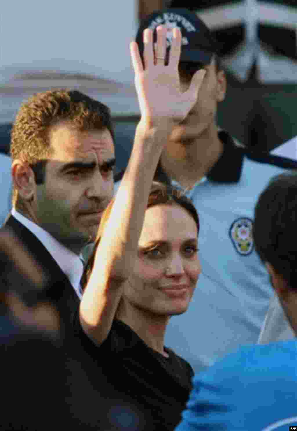 Angelina Jolie, the US actress and goodwill ambassador for the U.N. High Commissioner for Refugees, waves after her visit to a Syrian refugee camp in Turkish town of Altinozu in Hatay province, Turkey, Friday, June 17, 2011. Jolie traveled to Turkey's bo