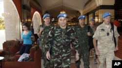 U.N. monitors walk through a hotel in Damascus, April 16, 2012.