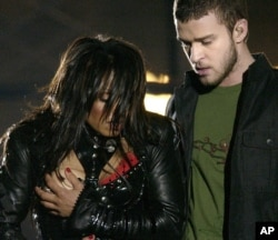 FILE - Entertainer Janet Jackson, left, covers her breast after her outfit came undone during the half-time performance with Justin Timberlake at Super Bowl XXXVIII in Houston, Feb. 1, 2004.