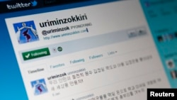 """North Korea's official Twitter account page, """"Uriminzokkiri,"""" which means """"by our nation,"""" on a computer screen in Seoul, Jan. 9, 2011."""