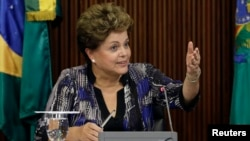 FILE - Brazil's President Dilma Rousseff speaks during a meeting with leaders of the Allied Base of parties in the Senate and House of Representatives at the Planalto Palace in Brasilia.