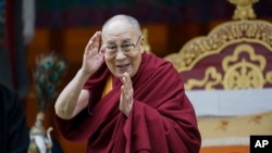 FILE- Tibetan spiritual leader the Dalai Lama greets devotees at the Buddha Park in Bomdila, Arunachal Pradesh, India, April 5, 2017.