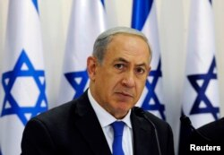 Israel's Prime Minister Benjamin Netanyahu heads a special cabinet meeting in Sde Boker in southern Israel, Nov. 10, 2013.