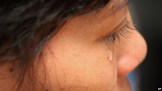 In this photo taken on Tuesday, Aug. 16, 2011, Cambodian maid Hok Pov, 31, cries as she speaks during an interview in Petaling Jaya, near Kuala Lumpur, Malaysia. Hok Pov may be poor but she had never been beaten or gone hungry until she came to work in Ma