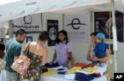 Locals in Guadalajara, Mexico learn about the history of Earth Day at the Earth Day Network/Bioalkimia booth during Dia De La Tierra 2010, organized by Bioalkimia and sponsored by Earth Day Network.
