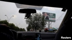 FILE - A billboard with the picture of Alfredo del Mazo of Institutional Revolutionary Party (PRI), candidate for governor of the State of Mexico, is seen in Metepec, State of Mexico, Mexico, May 16, 2017.
