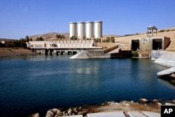 FILE - A general view of the dam in Mosul, 360 kilometers (225 miles) northwest of Baghdad, Iraq.