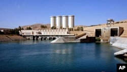 "FILE - A general view of the dam in Mosul, 360 kilometers (225 miles) northwest of Baghdad, Iraq. In late February, the U.S. Embassy in Baghdad called the dam's risk of collapse ""serious and unprecedented."""