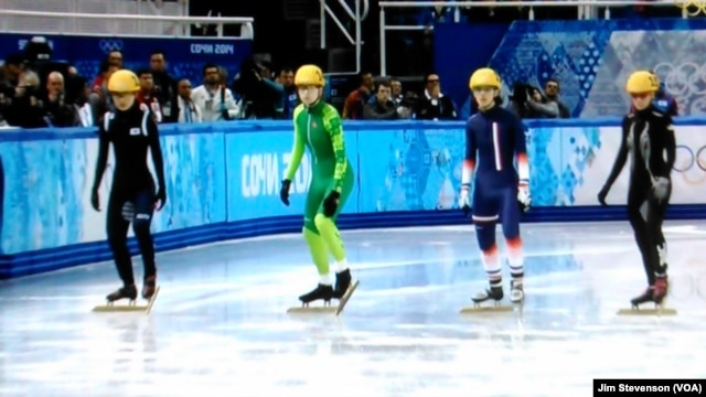 Skaters compete at the 2014 Winter Olympics.