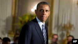 FILE - President Barack Obama arrives in State Dining Room of the White House, June 14, 2013.