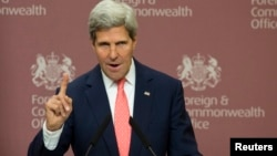 U.S. Secretary of State John Kerry gestures during his joint news conference with Britain's Foreign Secretary William Hague (not pictured) at the Foreign and Commonwealth Office in London September 9, 2013.