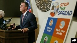 FILE - Oklahoma Gov. Kevin Stitt speaks during a news conference in Oklahoma City, July 9, 2020.
