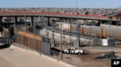 In this Tuesday, Jan. 22, 2019, photo, a new barrier is built along the Texas-Mexico border near downtown El Paso. Such barriers have been a part of El Paso for decades and are currently being expanded.