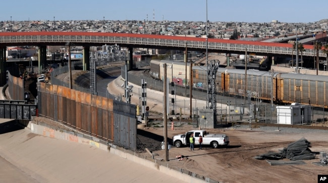 FILE - A new barrier is built along the Texas-Mexico border near downtown El Paso, Jan. 22, 2019.
