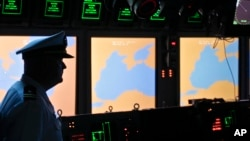 FILE - A U.S. Navy officer is seen on the USS Monterey as screens display the Black Sea region, in the port of Constanta, Romania, June 7, 2011. On Thursday, U.S. and NATO officials will declare operational a missile defense shield at one of its sites in Deveselu, Romania.