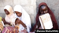Girls and women embroider caps and other items to sell from Kawar Maila, an informal camp in Maiduguri, Nigeria. (Haruna Shehu/VOA)