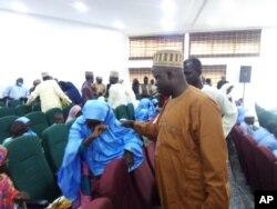 A freed student of Salihu Tanko Islamic School reunites with her father in Minna, Nigeria, Aug 27, 2021.