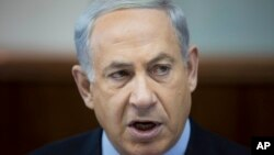Israeli Prime Minister Benjamin Netanyahu attends the weekly cabinet meeting at his office in Jerusalem, Nov. 24, 2013.