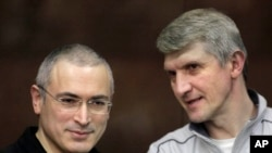 FILE - Mikhail Khodorkovsky, left, and co-defendant Platon Lebedev.