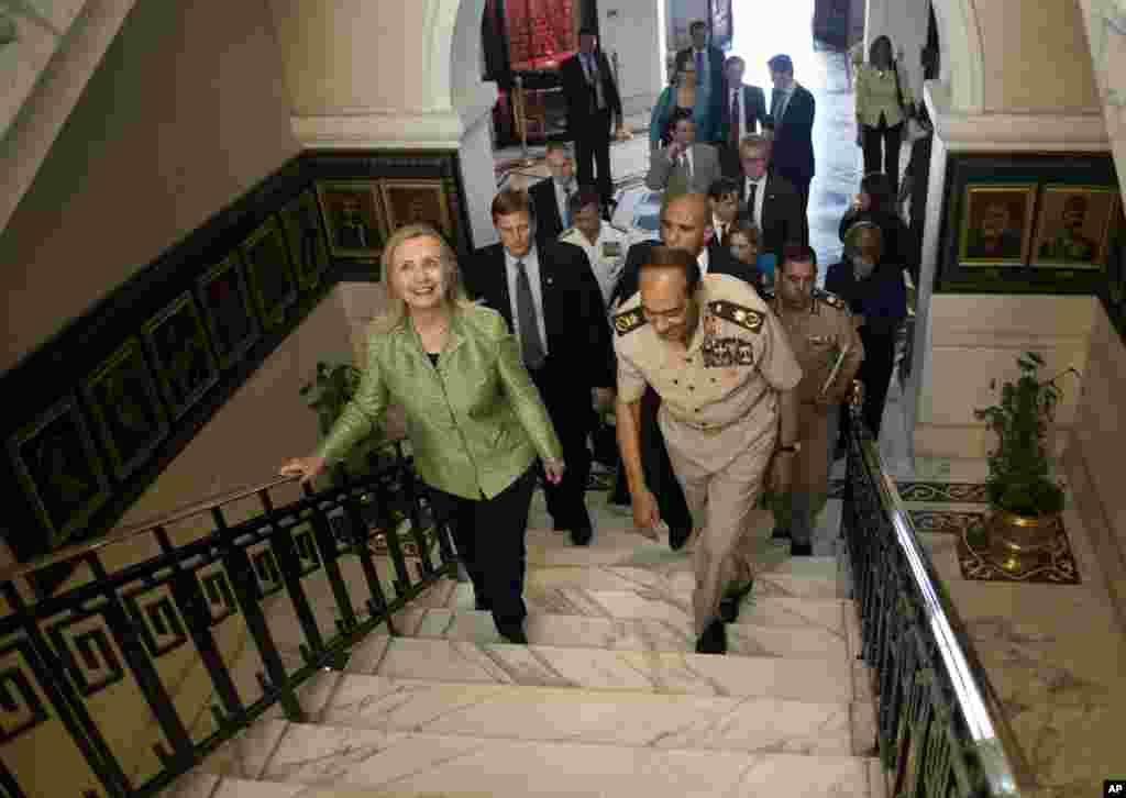 Egypt's Field Marshal Hussein Tantawi walks with U.S. Secretary of State Hillary Clinton at the Ministry of Defense, Cairo, Egypt, July 15, 2012.