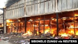 A fire engulfs Campsdrift Park following protests that have widened into looting in Pietermaritzburg, South Africa, July 13, 2021, in this screen grab taken from a video obtained from social media. (Courtesy Sibonelo Zungu/via Reuters)
